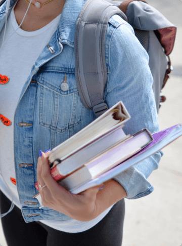 Women Holding Learning Books